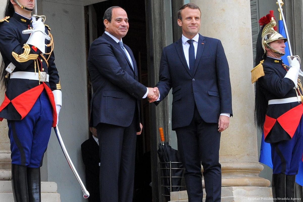 President of France Emmanuel Macron (2nd R) and President of Egypt Abdel Fattah al-Sisi (2nd L) shake hands during an official welcoming ceremony at the Elysee Palace in Paris, France on 24 October 2017 [Egyptian Presidency/Anadolu Agency]