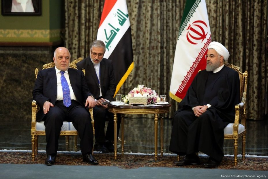 Iraqi Prime Minister Haider al-Abadi (L) meets with President of Iran Hassan Rouhani (R) at the Sadabad Palace in Tehran, Iran on 26 October 2017 [Iranian Presidency/ Anadolu Agency]