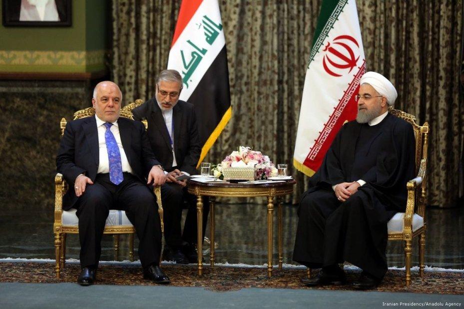 Iraqi Prime Minister Haider al-Abadi (L) meets with President of Iran Hassan Rouhani (R) at the Sadabad Palace in Tehran, Iran on 26 October 2017 [Iranian Presidency/ Anadolu Agency]