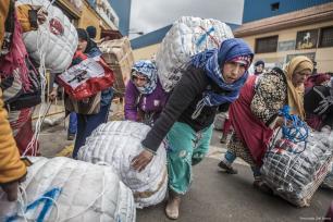 Women can be seen carrying heavy goods on their backs across the Spanish-Moroccan border [Fernando Del Berro]