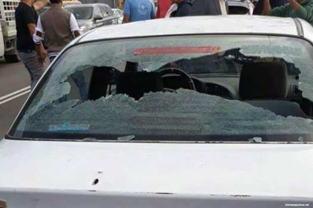 A shattered windscreen is seen after Israeli occupation forces opened fire at a Palestinian man and his sister in West Bank [Alkhaleejonline.net]