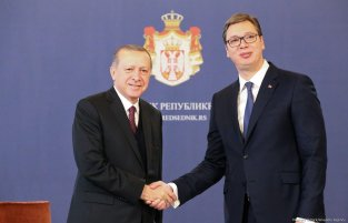 President of Turkey Recep Tayyip Erdogan (L) shakes hands with President of Serbia Aleksandar Vucic (R) during their meeting after an official welcoming ceremony at the Palace of Serbia in Belgrade, Serbia on 10 October, 2017 [Mustafa Öztürk/Anadolu Agency]