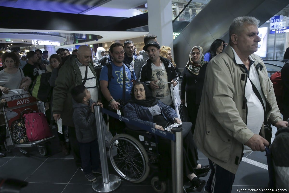 People wait at Athens International Airport as 234 refugees are transferred to Lyon of France within the EU Relocation Programme of International Organization for Migration (IOM) in Athens, Greece on 18 October, 2017 [Ayhan Mehmet/Anadolu Agency]