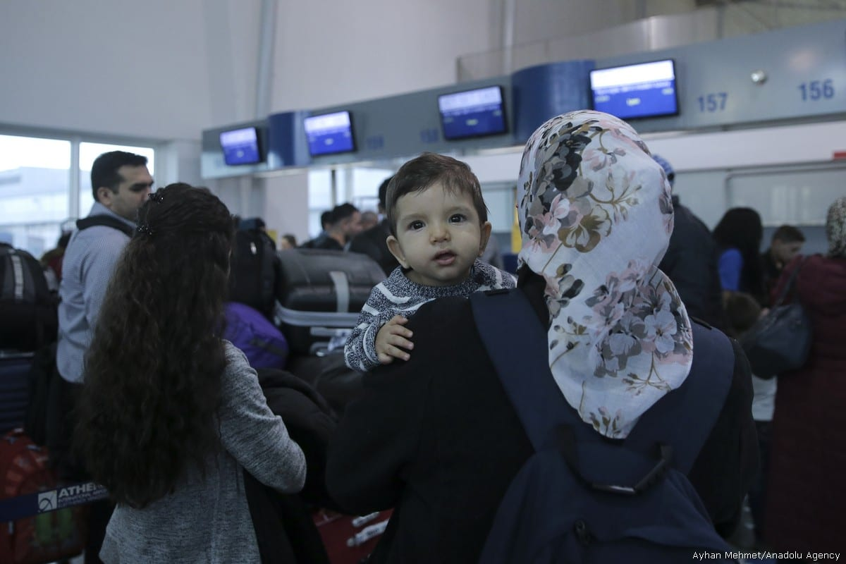 A baby is seen at Athens International Airport as 234 refugees are transferred to Lyon of France within the EU Relocation Programme of International Organization for Migration (IOM) in Athens, Greece on 18 October, 2017 [Ayhan Mehmet/Anadolu Agency]