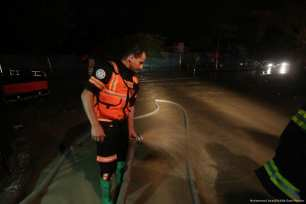An emergency rescue team can be seen after heavy rainfall blocked roads in Gaza on 27 November 2017 [Mohammed Asad/Middle East Monitor]