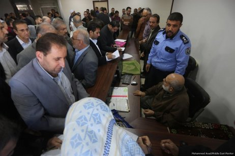 Former employers of the government gather inside the government building in the occupied West Bank [Mohammed Asad/Middle East Monitor]