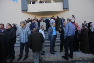 Former employers of the government gather outside the government building in the occupied West Bank [Mohammed Asad/Middle East Monitor]