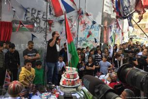 British street artist Banksy unveiled a new artwork during an 'apology' tea party for Palestinians to mark 100 years since Balfour Declaration on 1 November 2017 [Krishnan Guru-Murthy/Twitter]