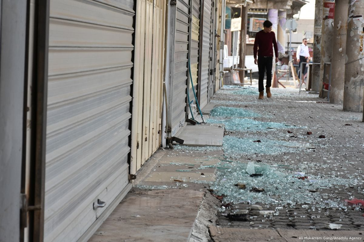 Broken glass pieces of stores are seen after an explosion took place in in Kirkuk, Iraq [Ali Mukarrem Garip/Anadolu Agency]