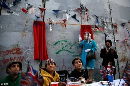 British street artist Banksy unveiled a new artwork during an 'apology' tea party for Palestinians to mark 100 years since Balfour Declaration on 1 November 2017 [Mazazikh/Facebok]