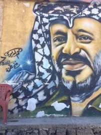 Artwork of Yasser Arafat is seen on a wall in Rashidieh, the largest Palestinian refugee camp in Tyre, Lebanon