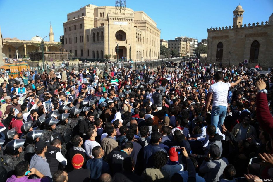 Egyptian protesters shout slogans as they stage a protest against US President Donald Trump's announcement to recognise Jerusalem as the capital of Israel, after Friday Prayer at Al-Azhar Mosque in Cairo, Egypt on December, 8, 2017 [Stringer / Anadolu Agency]