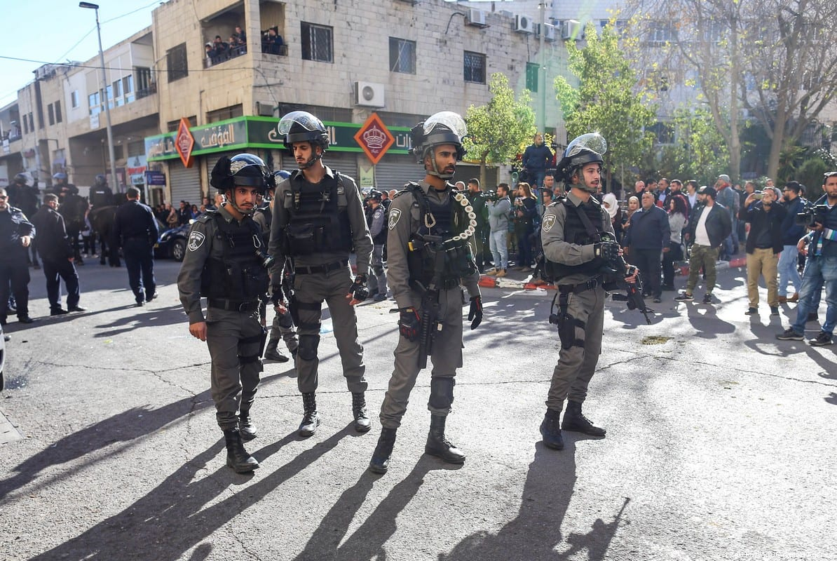 Israeli occupation forces stand watch as Palestinian protest on 9 December 2017 in Jerusalem against US President Donald Trump's decision to recognise Jerusalem as Israel's capital . [Salih Zeki Fazlıoğlu/Anadolu Agency]