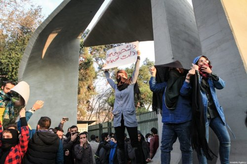 People gather to protest over high cost of living in Tehran, Iran on December 30, 2017 [Stringer / Anadolu Agency]
