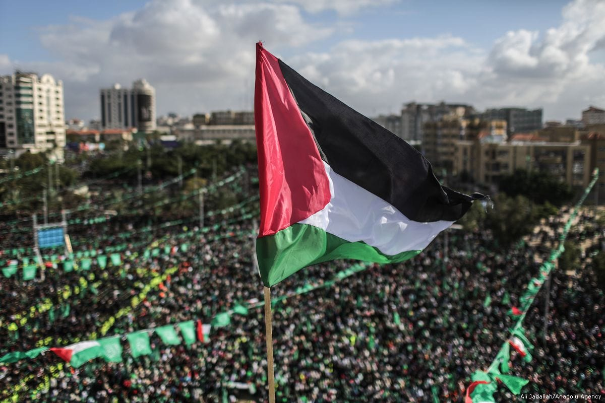 Palestinian people gather at Al-Katiba Square during an event held to mark the 30th anniversary of Hamas, on December 14, 2017 in Gaza City, Gaza [Ali Jadallah / Anadolu Agency]