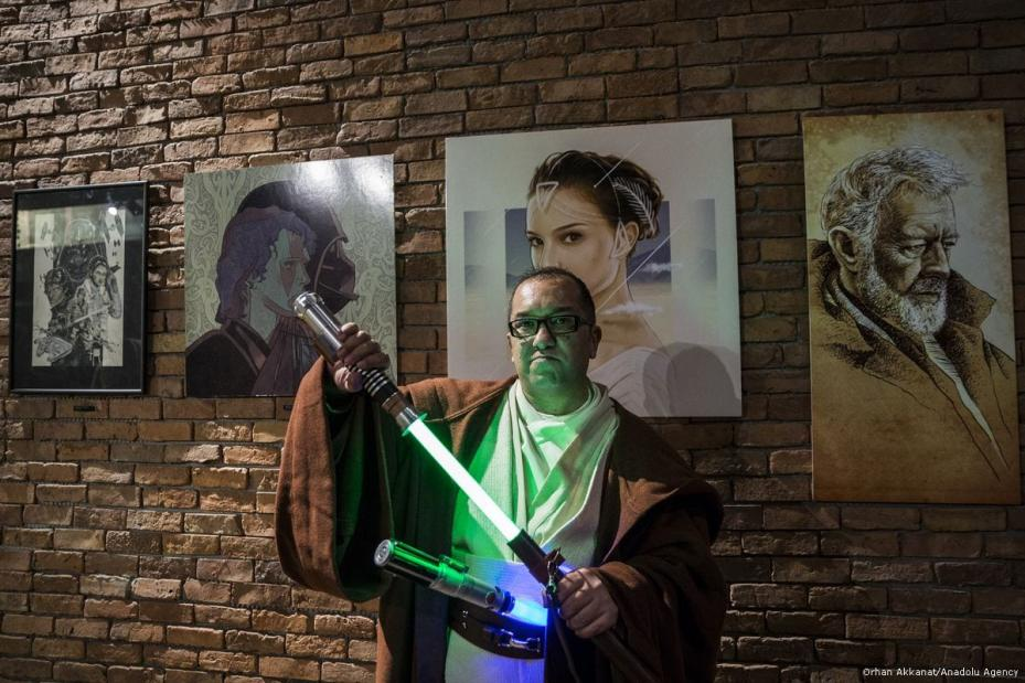 Fans with Star Wars costumes pose for a photo during a gathering for the latest of the Star Wars film series 'Star Wars: The Last Jedi' in Istanbul, Turkey on 13 December 2017 [Orhan Akkanat/Anadolu Agency]
