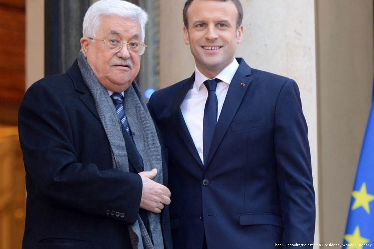 Palestinian President Mahmoud Abbas (L) is welcomed by French President Emmanuel Macron (R) at the Elysee Palace in Paris, France on December 22, 2017. [Thaer Ghanaim/ Palestinian Presidency]