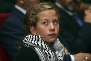 Photo dated in December 2012 shows Palestinian girl Ahed al-Tamimi during an award ceremony in which she was awarded with the 'Hanzala Courage Award' [Şebnem Coşkun/Anadolu Agency]