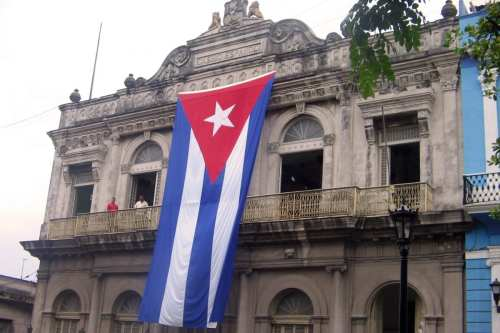 The Cuban flag flies above a building in Matanzas