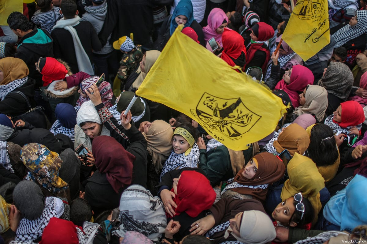 Palestinians gather to mark the 53rd Foundation anniversary of Palestinian Fatah movement at Unknown Soldiers Monument in Gaza City, Gaza on December 31, 2017 [Ali Jadallah / Anadolu Agency]