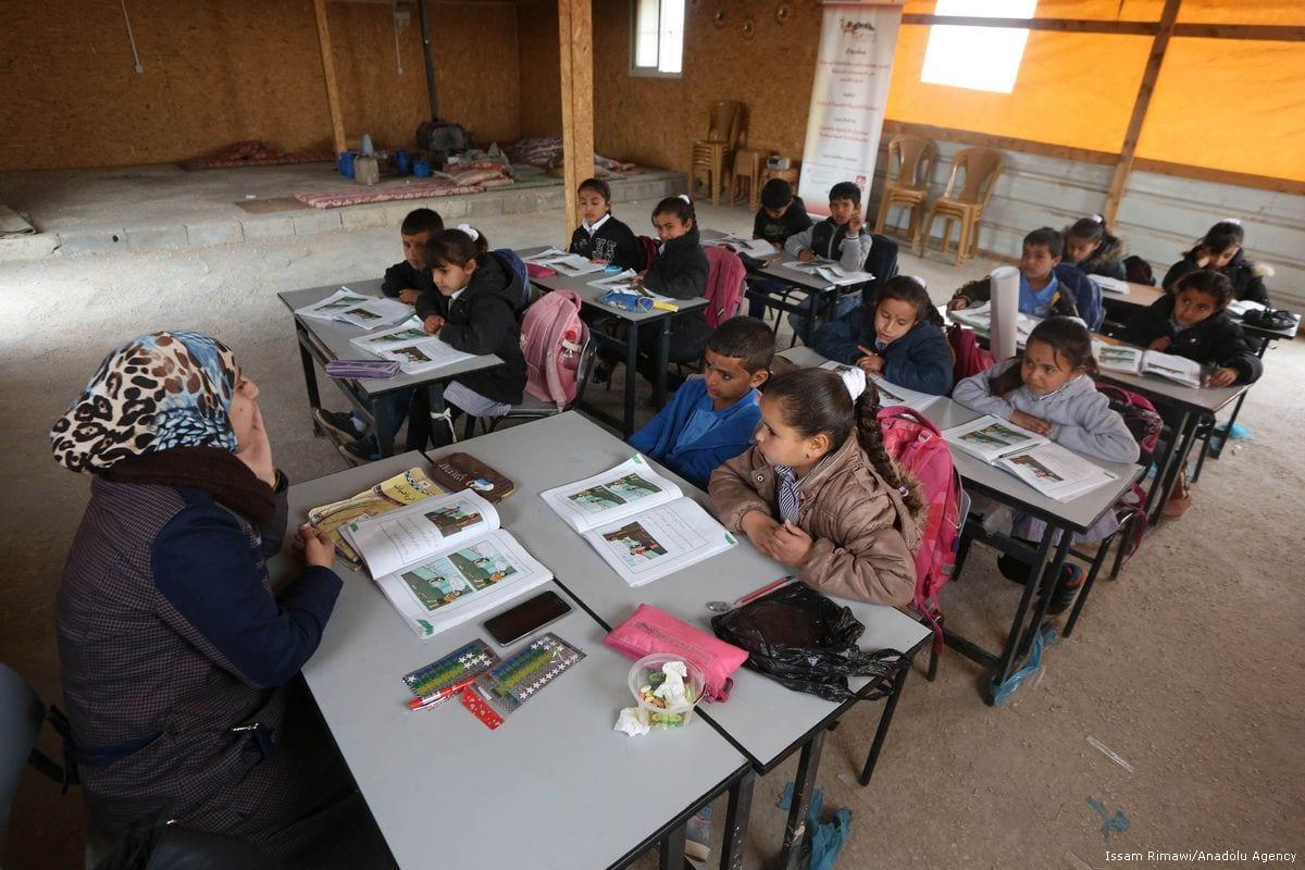 Palestinian children attend class in a school in Jerusalem on 3 January 2018 [Issam Rimawi/Anadolu Agency]
