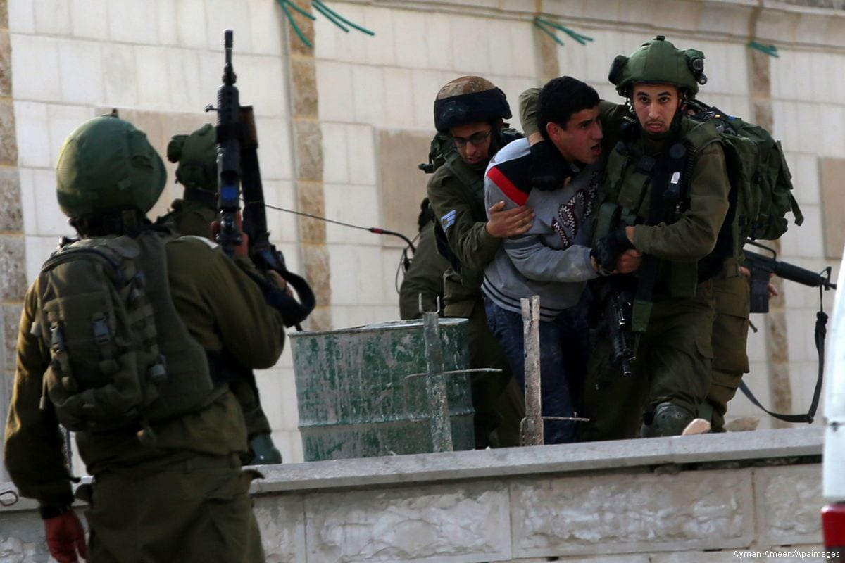 Israeli occupation forces arrest a Palestinian protester in the West Bank [Ayman Ameen/Apaimages]