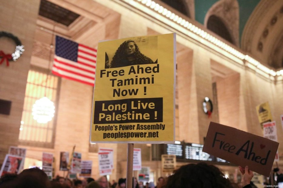 Protesters hold posters and banners during a protest in solidarity with the16-year-old Palestinian Ahed al-Tamimi, who was taken into custody by Israeli soldiers, and Palestinian prisoners in Israeli jails at Grand Central Terminal in New York, United States on January 5, 2017 [Atılgan Özdil / Anadolu Agency]