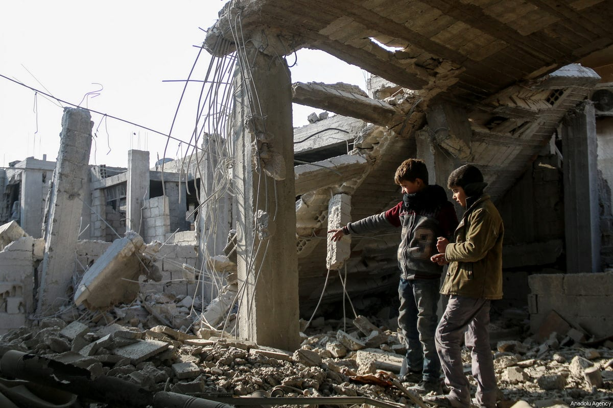 Wreckages of collapsed buildings are seen after Assad Regime's war crafts carried out airstrikes over the de-escalation zone of Hamouriyah district of besieged Eastern Ghouta in Damascus, Syria on January 06, 2018 [Samir Tatin / Anadolu Agency]