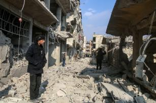 Wreckages of collapsed buildings are seen after Assad Regime's airplanes and artillery units hit the de-escalation zone of Arbin town in the besieged Eastern Ghouta in Damascus, Syria on January 06, 2018 [Ammar Al-Bushy / Anadolu Agency]
