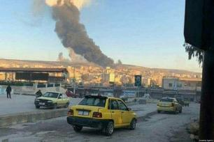 Smoke from explosion is seen after Turkish jets destroyed observation posts and many other targets of PYD/PKK as part of the 'Operation Olive Branch' in Afrin, Syria on January 20, 2018 [Stringer / Anadolu Agency]