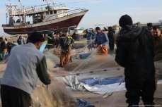 Gaza fishermen [Mohammed Asad/Middle East Monitor]
