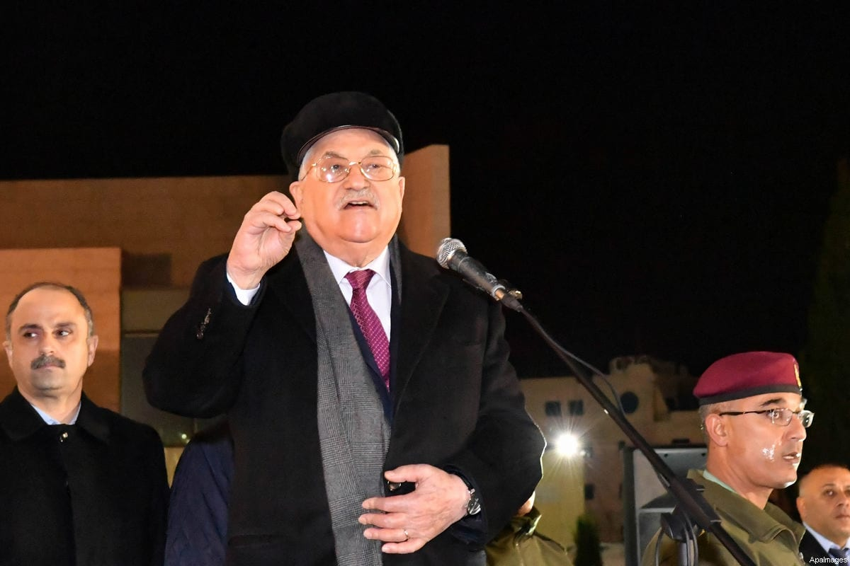 Palestinian president Mahmud Abbas speaks outside the tomb of the late President Yasser Arafat during a celebration marking the fifty-third anniversary of the creation of the Fatah movement in the West Bank city of Ramallah on December 31, 2017 [Thaer Ganaim / ApaImages]