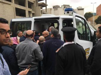 An ambulance arrives to the scene after Hisham Geneina was attacked outside his home in Cairo, Egypt