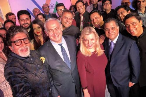 Israeli Prime Minister Benjamin Netanyahu takes a selfie with his wife Sara Netanyahu and Bollywood stars including Amitabh Bachchan (left) during his trip to India on January 18, 2018 [Twitter / netanyahu]