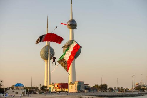 A sky diver seen during the Kuwait National Day celebrations in February 2016, in front the Kuwait Towers in Kuwait City, Kuwait [Youtube screengrab]