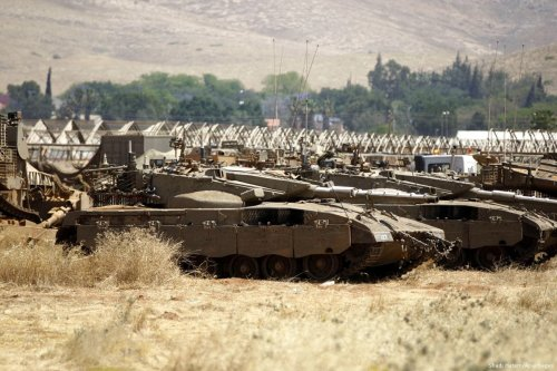Israeli military's tanks seen stationed in the Jordan Valley during a military training excercise, on May 5, 2015 [Shadi Hatem/Apaimages]