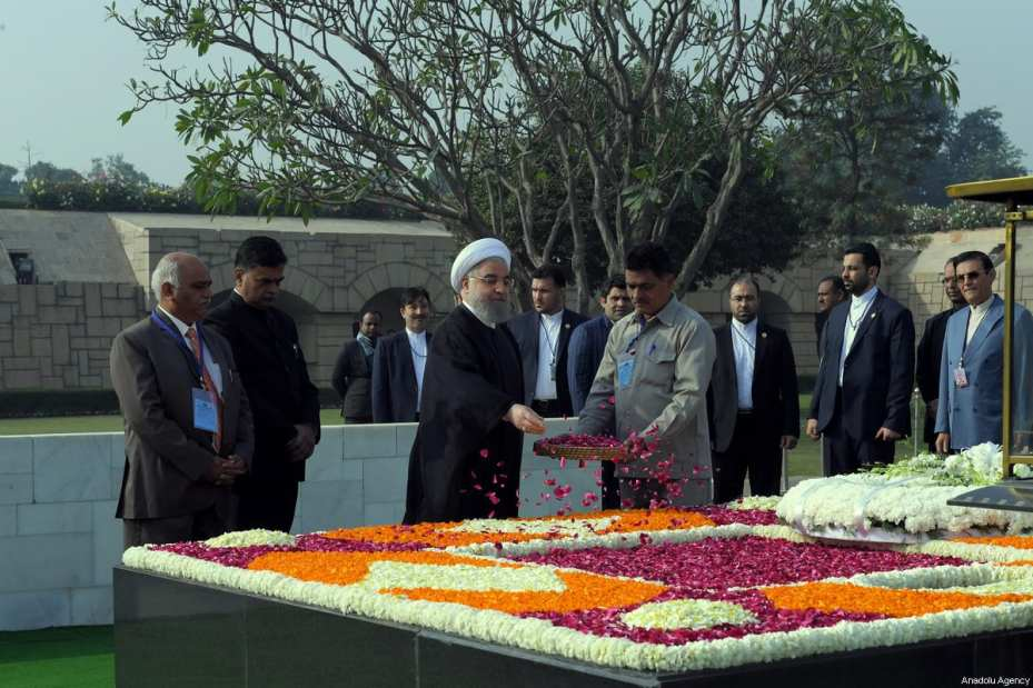 Iranian President Hassan Rouhani (3rd L) scatters petals on the Mausoleum of Mahatma Gandhi, who was the leader of the Indian independence movement, in New Delhi, India on February 17, 2018 [Iranian Presidency / Handout / Anadolu Agency]