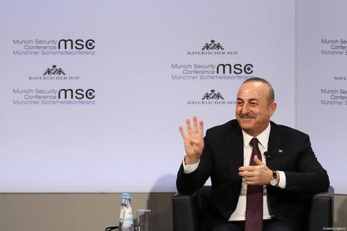 """Turkish Foreign Minister Mevlut Cavusoglu attends the """"Enlargement of Gulf"""" discussion platform on the sidelines of 'Munich Security Conference' in Munich, Germany on 18 February, 2018 [Abdülhamid Hoşbaş/Anadolu Agency]"""