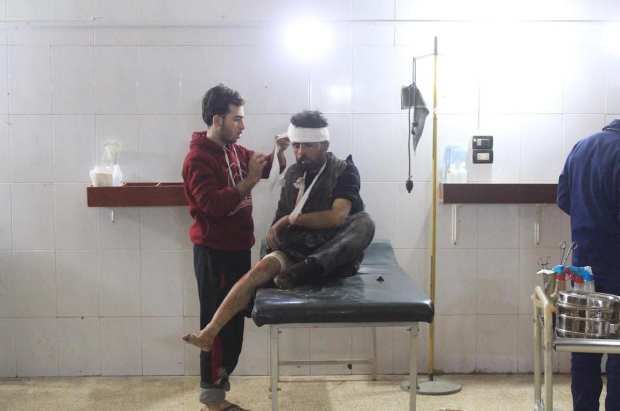 A Syrian man receives medical treatment at the field hospital after Assad Regime's airstrikes and ground attacks to the Hammuriya town in the Eastern Ghouta region of Damascus, Syria on 19 February, 2018 [Abdul Moyeen Homs/Anadolu Agency]
