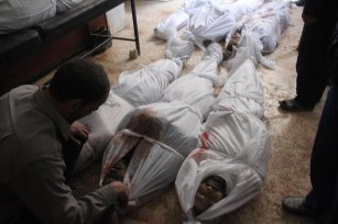 Dead bodies of civilians are seen at the morgue of field hospital after Assad Regime's airstrikes and ground attacks to the Hammuriya town in the Eastern Ghouta region of Damascus, Syria on 19 February, 2018 [Abdul Moyeen Homs/Anadolu Agency]