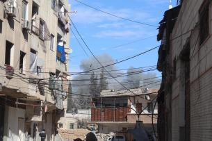 Smoke rises after Assad Regime's airstrikes and ground attacks to the Hammuriya town in the Eastern Ghouta region of Damascus, Syria on 19 February, 2018 [Abdul Moyeen Homs/Anadolu Agency]