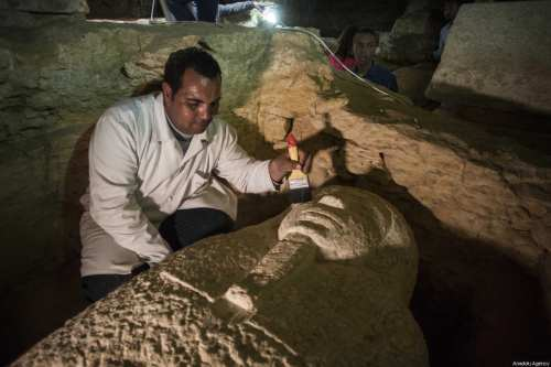 An archeologist works on one of the 3,000-Year-Old 8 pharaohs' tomb, which were dug out during archaeological excavations, in Minya, Egypt on February 24, 2018 [İbrahim Ramadan / Anadolu Agency]