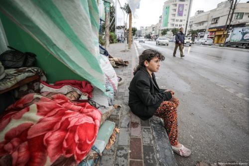 A Palestinian child is seen outside her makeshift tent in Gaza City, Gaza [Ali Jadallah/Anadolu Agency]