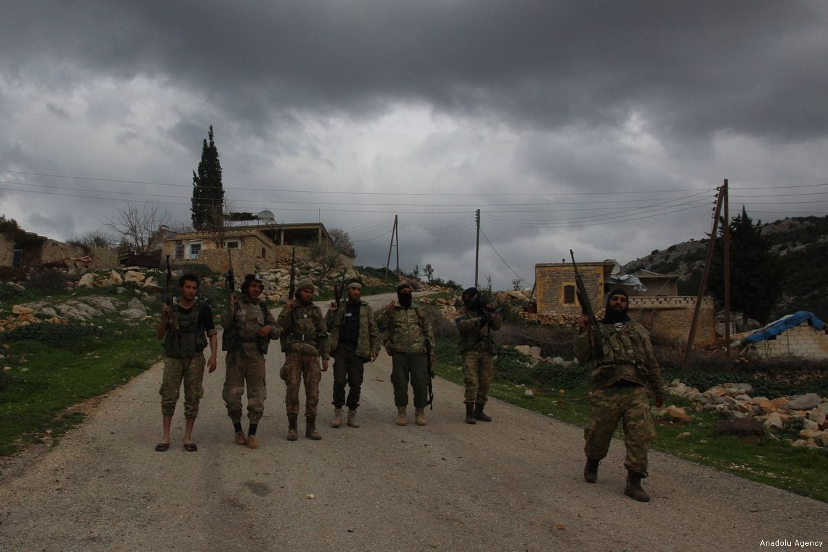 Free Syrian Army members during the 'Operation Olive Branch' in northwest of Afrin's Rajo town in Syria, on 15 February 2018 [Beha el Halebi/Anadolu Agency]
