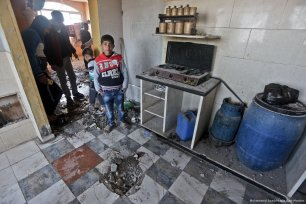 Gazans look at the damage done to their home after Israel carried out a missile attack in Gaza on 1 February 2018 [Mohamemd Asad/Middle East Monitor]