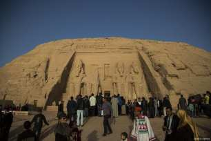 Visitors arrive to monitor the sunbeams on the statues of King Ramesses II at Abu Simbel in Aswan, Egypt on 22 February 2017 This occurrence happens twice per a year for twenty minutes on Ramses II's coronation day, 22nd February, and his birthday, 22nd October [İbrahim Ramadan/Anadolu Agency]