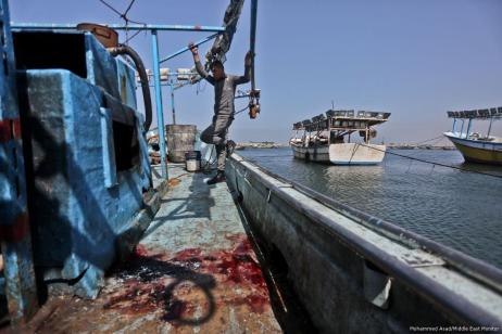 Bullet holes can be seen following the Israeli attack on a Palestinian fishing boat off the coast of Gaza on 25 February 2018 [Mohammed Asad/Middle East Monitor]