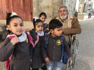 Sameer Salim is seen with Palestinian children