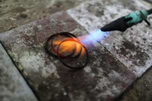 GAZA CITY, GAZA - MARCH 01: A craftsman is seen as he shapes a gold with the help of a heat in Gaza City, Gaza on March 01, 2018. Due to the ongoing market, and income stagnation and also the worsening economy, so many jewelry stores faced with lower purchasing power and cash shortage. ( Ali Jadallah - Anadolu Agency )