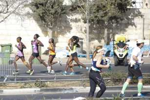 Participants compete during the 8th annual International Jerusalem Marathon in Jerusalem on March 09, 2018 [Mostafa Alkharouf / Anadolu Agency]